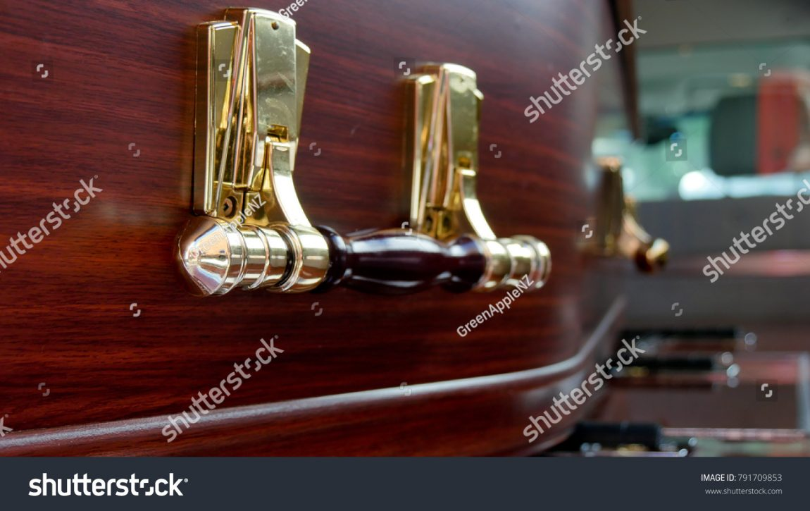 stock-photo-closeup-shot-of-a-colorful-casket-in-a-hearse-or-chapel-before-funeral-or-burial-at-cemetery-791709853.jpg